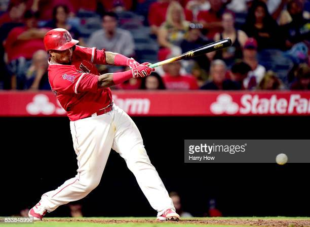 Martin Maldonado of the Los Angeles Angels hits a single during the sixth inning against the Tampa Bay Rays at Angel Stadium of Anaheim on July 14...