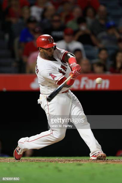 Martin Maldonado of the Los Angeles Angels of Anaheim bats during a game against the Philadelphia Phillies at Angel Stadium of Anaheim on August 3...