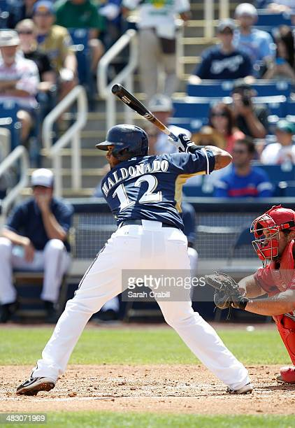 Martin Maldonado of the Milwaukee Brewers bats during a game against the Cincinnati Reds at Maryvale Baseball Park on March 27 2014 in Phoenix Arizona