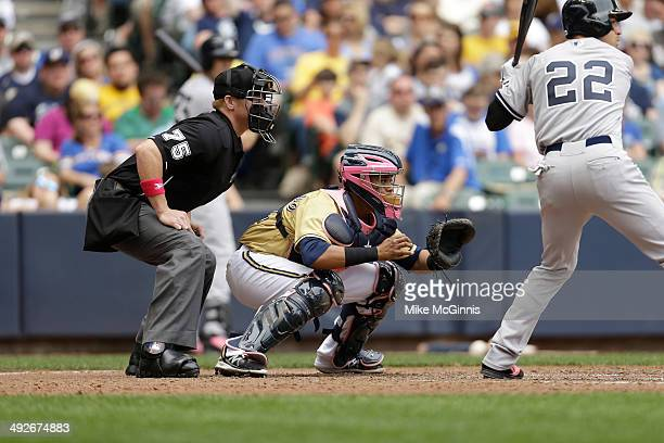 Martin Maldonado of the Milwaukee Brewers catches behind the plate during the Interleague game against the New York Yankees at Miller Park on May 11...
