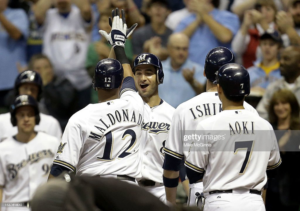 Martin Maldonado #12 of the Milwaukee Brewers celebrates after hitting a grand slam scoring <a gi-track='captionPersonalityLinkClicked' href=/galleries/search?phrase=Norichika+Aoki&family=editorial&specificpeople=850957 ng-click='$event.stopPropagation()'>Norichika Aoki</a>, Ryan Braun, and <a gi-track='captionPersonalityLinkClicked' href=/galleries/search?phrase=Travis+Ishikawa&family=editorial&specificpeople=551505 ng-click='$event.stopPropagation()'>Travis Ishikawa</a> in the bottom of the 3rd inning against the San Diego Padres at Miller Park on October 2, 2012 in Milwaukee, Wisconsin.