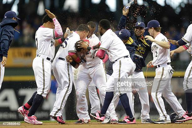 Martin Maldonado of the Milwaukee Brewers celebrates after hitting a walk off single in the twelfth inning against the Chicago Cubs at Miller Park on...