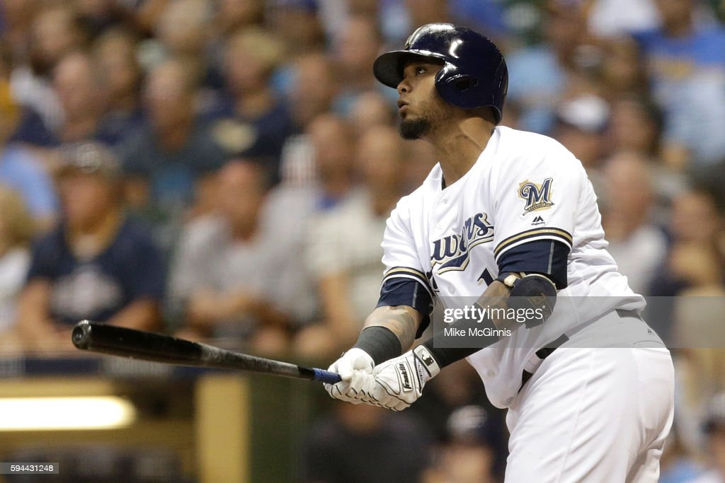 Martin Maldonado of the Milwaukee Brewers hits a RBI double scoring Chris Carter during the second inning against the Colorado Rockies at Miller Park...