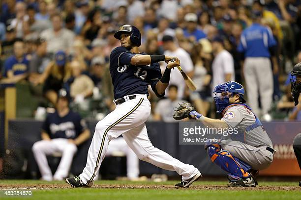 Martin Maldonado of the Milwaukee Brewers makes some contact at the plate during the Interleague game against the New York Mets at Miller Park on...