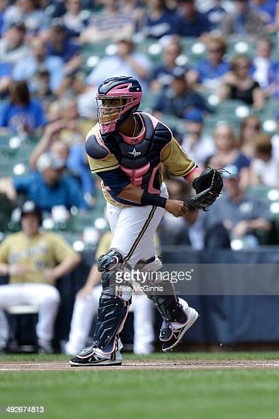 Martin Maldonado of the Milwaukee Brewers makes the throw down to second base before the start of the inning against the New York Yankees during the...