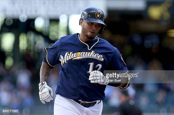Martin Maldonado of the Milwaukee Brewers rounds the bases after hitting a home run in the ninth inning against the Washington Nationals at Miller...