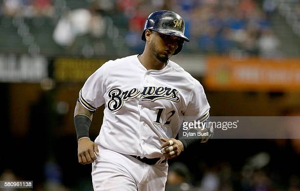 Martin Maldonado of the Milwaukee Brewers rounds the bases after hitting a home run in the sixth inning against the Arizona Diamondbacks at Miller...
