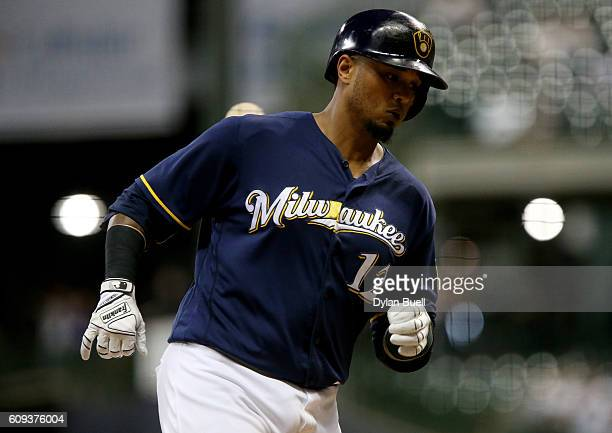 Martin Maldonado of the Milwaukee Brewers rounds the bases after hitting a home run in the fourth inning against the Pittsburgh Pirates at Miller...