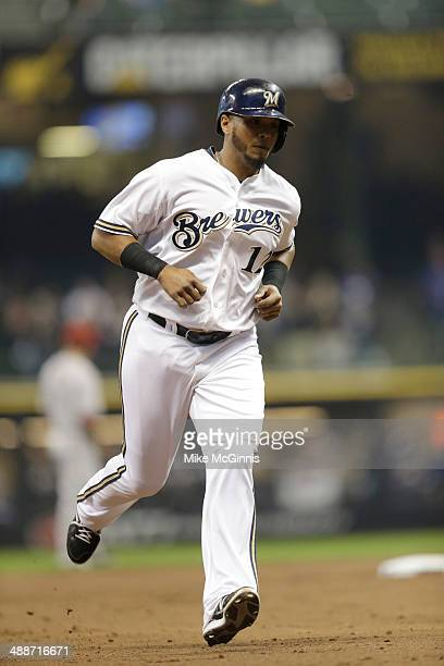 Martin Maldonado of the Milwaukee Brewers runs the bases after hitting a two run homer in the bottom of the second inning against the Arizona...