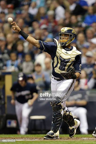 Martin Maldonado of the Milwaukee Brewers throws around the infield after making an out during the game against the San Diego Padres at Miller Park...