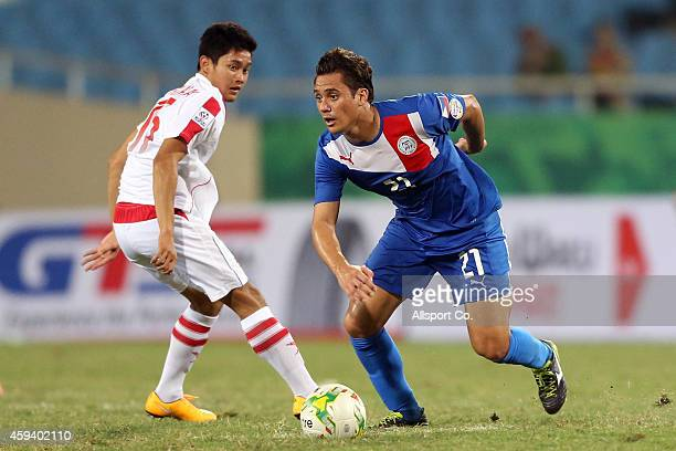 Martin Marcus of the Philippines shields the ball away from P Thenthong of Laos during the 2014 AFF Suzuki Cup Group A match between the Philippines...
