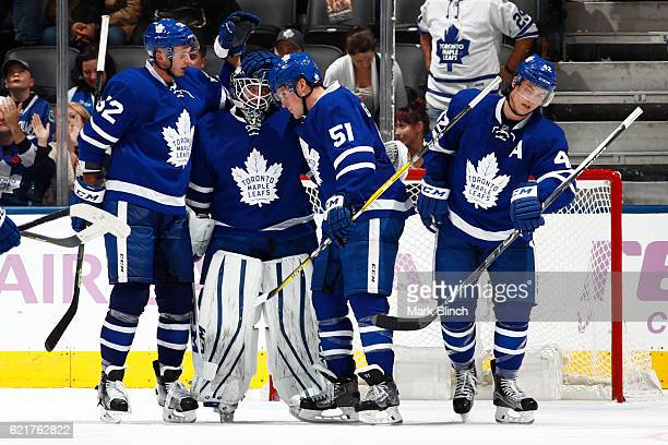 Martin Marincin Jhonas Enroth Jake Gardiner and Tyler Bozak of the Toronto Maple Leafs celebrate their win against the Vancouver Canucks during the...