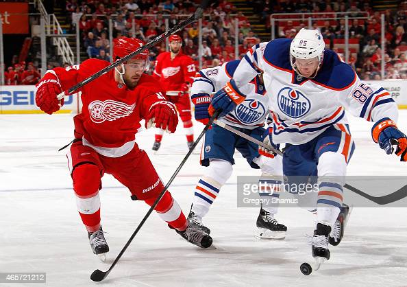 Martin Marincin of the Edmonton Oilers battles for the puck with Riley Sheahan of the Detroit Red Wings during the second period at Joe Louis Arena...