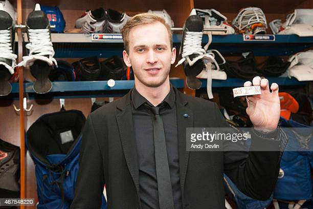 Martin Marincin of the Edmonton Oilers poses with the puck after scoring his first NHL goal following the game against the Colorado Avalanche on...