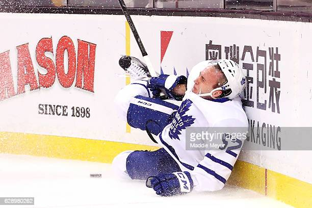 Martin Marincin of the Toronto Maple Leafs crashes into the boards during the first period against the Boston Bruins at TD Garden on December 10 2016...