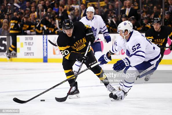 Martin Marincin of the Toronto Maple Leafs defends Riley Nash of the Boston Bruins during the first period at TD Garden on December 10 2016 in Boston...