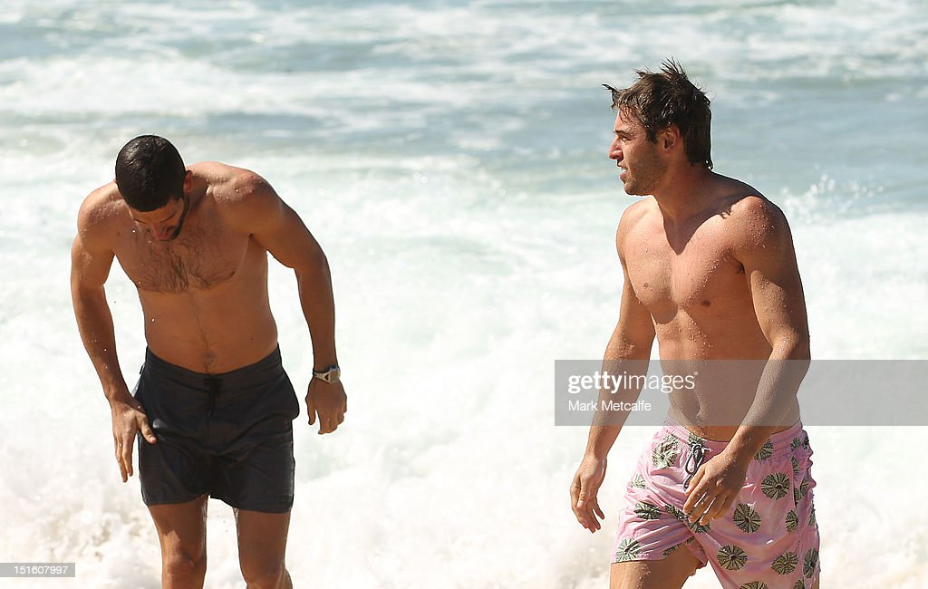 Martin Mattner and Nick Smith of the Swans walk out of the ocean during a Sydney Swans media session at Coogee Beach on September 9, 2012 in Sydney, Australia.