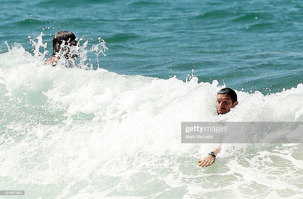 Martin Mattner of the Swans body surfs during a Sydney Swans media session at Coogee Beach on September 9, 2012 in Sydney, Australia.