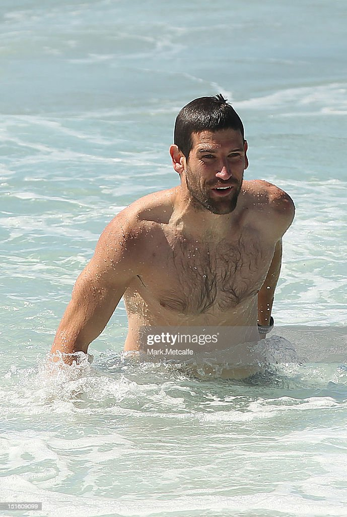 Martin Mattner of the Swans walks out of the ocean during a Sydney Swans media session at Coogee Beach on September 9, 2012 in Sydney, Australia.