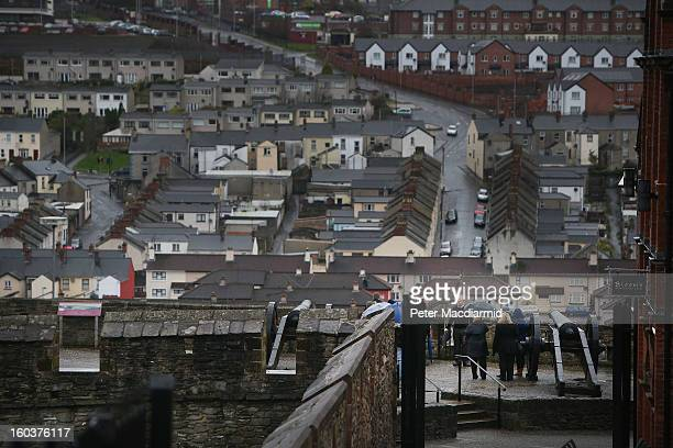 Martin McCrossan gives a guided tour from the city walls here over looking the Catholic Bogside area on January 30 2013 in Londonderry Northern...