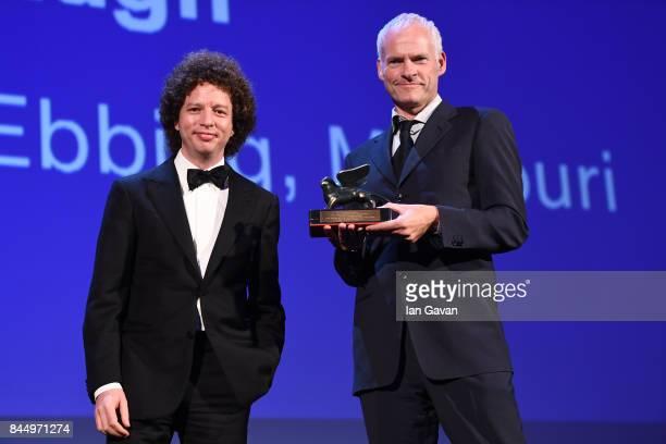 Martin McDonagh receives the Best Screenplay Award for 'Three Billboards Outside Ebbing Missouri' from 'Venezia 74' jury member Michel Franco during...