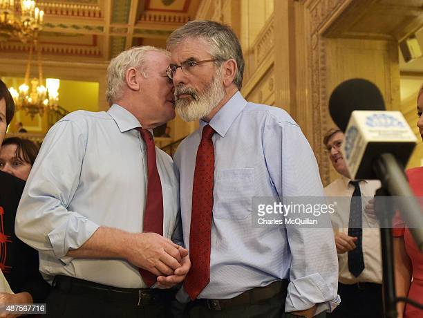 Martin McGuinness and Gerry Adams confer before speaking to the press at Stormont on September 10 2015 in Belfast Northern Ireland A political crisis...