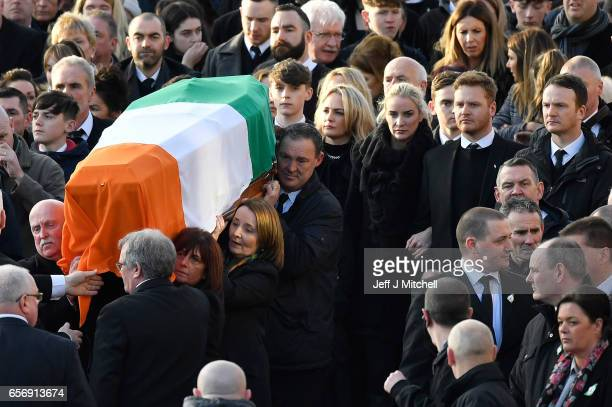 Martin McGuinness' children Fionnuala McGuinness Grainne McGuinness Fiachra McGuinness and Emmett McGuinness walk behind his coffin as they make...