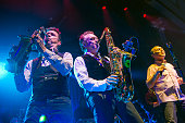 Martin Meredith Brian Travers and Duncan Campbell of UB40 perform on stage at the Assembly on November 26 2014 in Leamington Spa United Kingdom