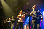 Martin Meredith Brian Travers Laurence Parry Duncan Campbell Norman Hassan and Robin Campbell of UB40 perform on stage at the Assembly on November 26...