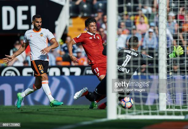 Martin Montoya and Diego Alves of Valencia competes for the ball with Joaquin Correa of Sevilla during the La Liga match between Valencia CF and...