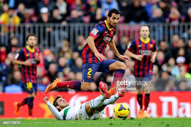 Martin Montoya of FC Barcelona duels for the ball with Ruben Perez of Elche FC during the La Liga match between FC Barcelona and Elche FC at Camp Nou...