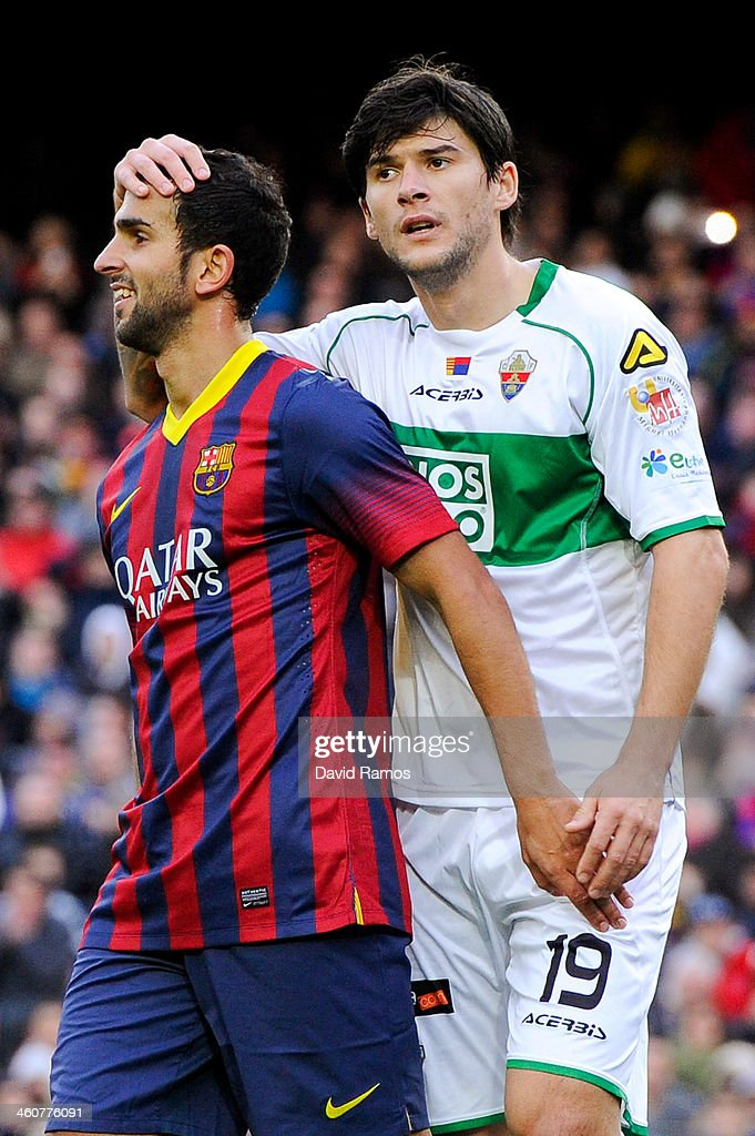 <a gi-track='captionPersonalityLinkClicked' href=/galleries/search?phrase=Martin+Montoya&family=editorial&specificpeople=5553159 ng-click='$event.stopPropagation()'>Martin Montoya</a> of FC Barcelona jokes with <a gi-track='captionPersonalityLinkClicked' href=/galleries/search?phrase=Cristian+Sapunaru&family=editorial&specificpeople=633831 ng-click='$event.stopPropagation()'>Cristian Sapunaru</a> of Elche FC during the La Liga match between FC Barcelona and Elche FC at Camp Nou on January 5, 2014 in Barcelona, Spain.