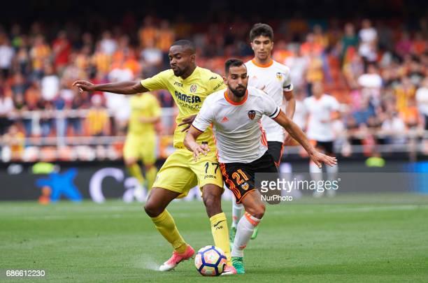 Martin Montoya of Valencia CF and Cedric Bakambu of Villarreal CF during their La Liga match between Valencia CF and Villarreal CF at the Mestalla...