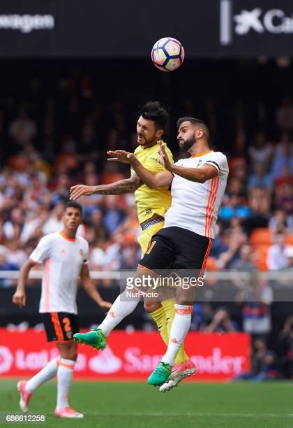 Martin Montoya of Valencia CF and Roberto Soriano of Villarreal CF during their La Liga match between Valencia CF and Villarreal CF at the Mestalla...