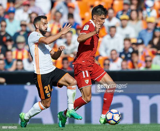 Martin Montoya of Valencia competes for the ball with Joaquin Correa of Sevilla during the La Liga match between Valencia CF and Sevilla FC at...