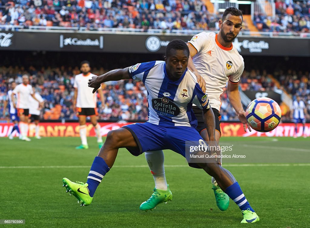 http://media.gettyimages.com/photos/martin-montoya-of-valencia-competes-for-the-ball-with-marlos-moreno-picture-id663792590