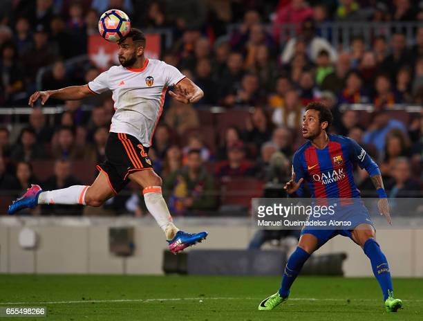 Martin Montoya of Valencia heads in front of Neymar JR of Barcelona during the La Liga match between FC Barcelona and Valencia CF at Camp Nou Stadium...
