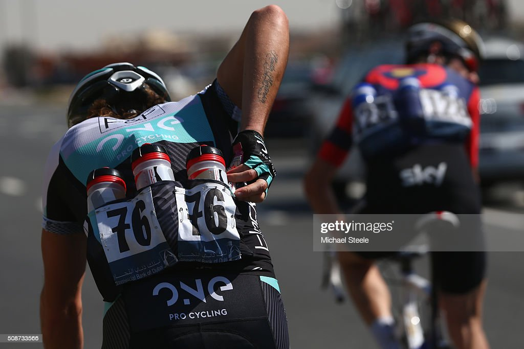 Martin Mortensen of Denmark and One Pro Cycling gathers bottle for team mates during the Business Bay Stage Four of the Tour of Dubai on February 6, 2016 in Dubai, United Arab Emirates.