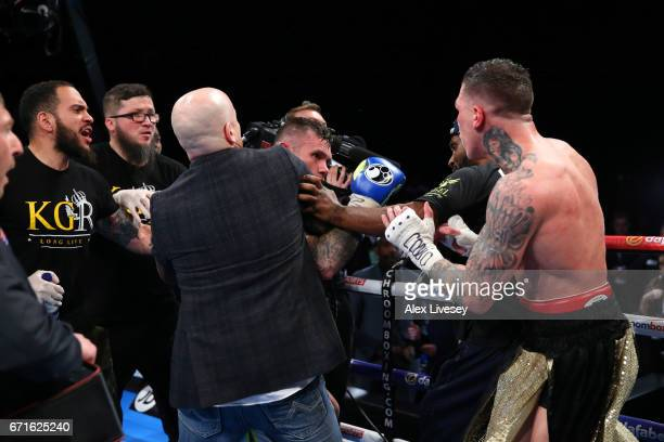 Martin Murray and Gabriel Rosado are pulled apart as they clash as the result is announced after the WBA InterContinental Middleweight title fight...