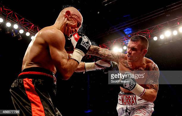 Martin Murray lands a right jab on the chin of Sergey Khomitsky during their Middleweight bout at ExCel on December 14 2013 in London England