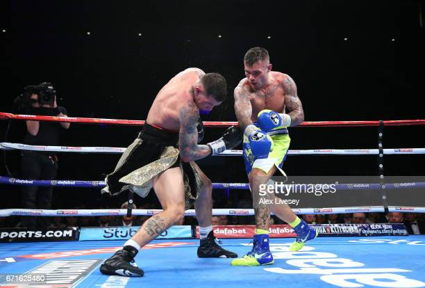 Martin Murray lands a right shot on Gabriel Rosado during the WBA InterContinental Middleweight title fight between Martin Murray and Gabriel Rosado...