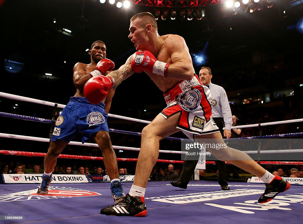 Martin Murray of Great Britain (R) in action with Jorge Navarro of Venezuela during their WBA Interim Middleweight Title bout at the MEN Arena on November 24, 2012 in Manchester, England.