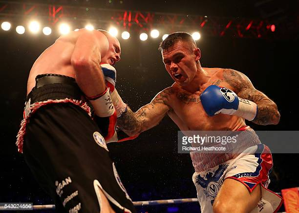 Martin Murray of Great Britain lands a punch on George Groves of Great Britain during their WBA International SuperMiddleweight Championship contest...