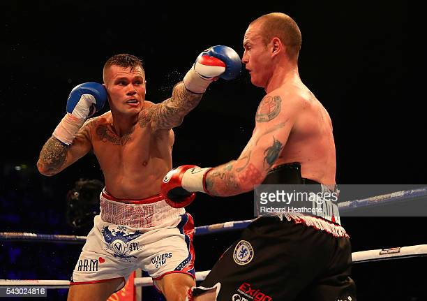 Martin Murray of Great Britain throws a punch at George Groves of Great Britain during their WBA International SuperMiddleweight Championship contest...