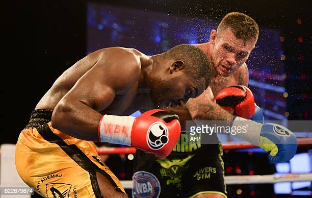 TOPSHOT Martin Murray of Great Britain unleashes a right against Nuhu Lawal of Germany during their WBA Continental Super Middleweight fight on...