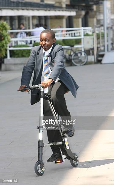 Martin Mwangi of the St Martin's School in London test drives the Abike a new lightweight folding bicycle which was launched in London UK Wednesday...