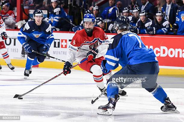 Martin Necas of Team Czech Republic looks to play the puck past Olli Juolevi of Team Finland during the IIHF World Junior Championship preliminary...