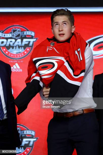 Martin Necas puts on the Carolina Hurricanes jersey after being selected 12th overall during the 2017 NHL Draft at the United Center on June 23 2017...