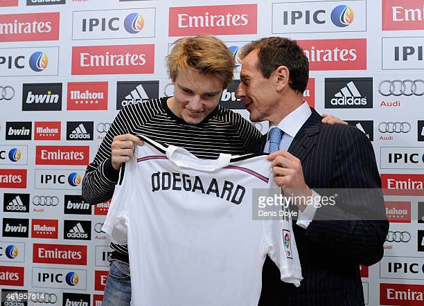 Martin Odegaard from Norway holds his new Real Madrid shirt with former Real player Emilio Butragueno during a press conference at Real Madrid's...