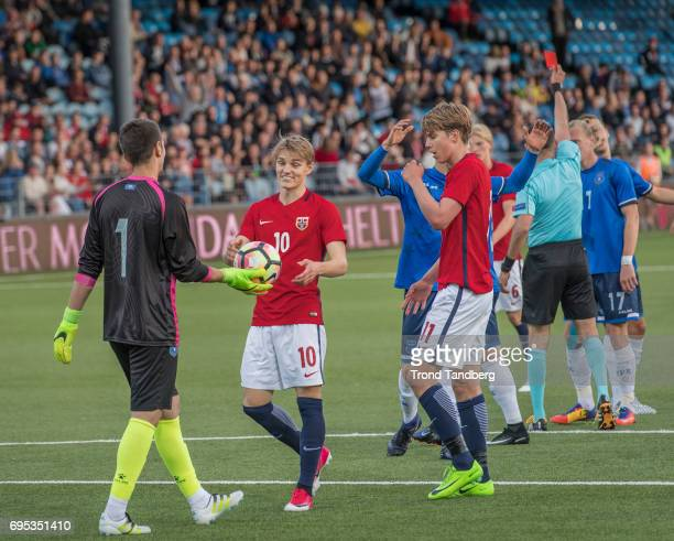 Martin Odegaard Martin Samuelsen of Norway Visar Bekaj in front when Besfort Kolgeci have the red card from Referee Alex Troleis of FRO during the...